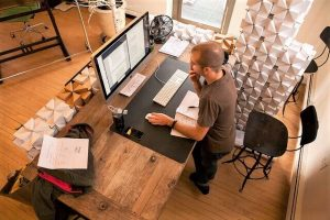 is sitting bad for you? photo of man at standing work station
