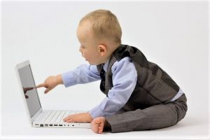 is sitting bad for you? photo of baby sitting and pointing to laptop screen