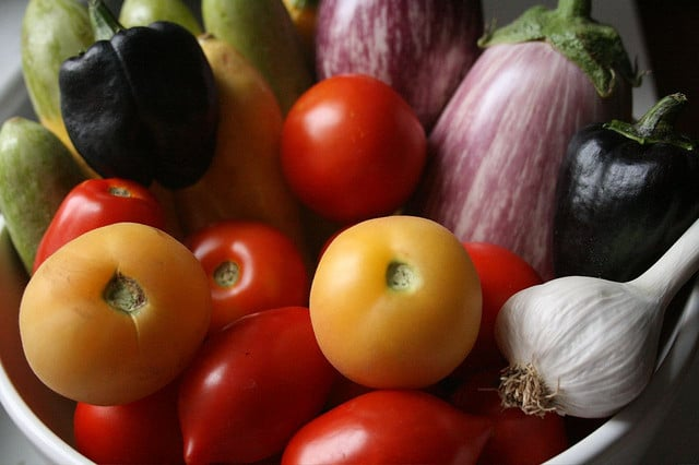 go green -- photo of tomatoes, eggplants, and garlic in bowl