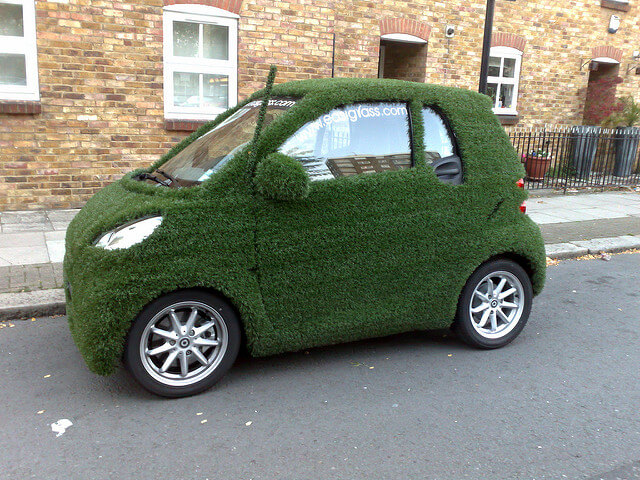 go green -- photo of Smartcar covered in astroturf