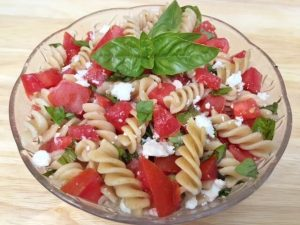 healthy pasta recipe -- pasta, tomatoes, and basil in bowl