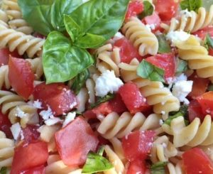healthy pasta recipe --pasta, tomatoes, and basil closeup