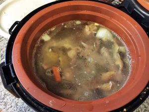 closeup of bone broth in slowcooker