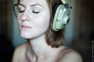 reduce cortisol -- photo of woman wearing headphones