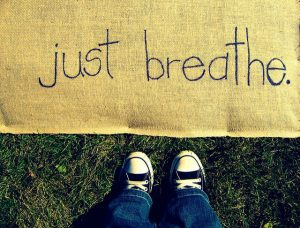 "you can reduce cortisol with deep breathing -- photo of banner that says ""just breathe"""