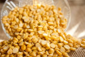 eat healthy on a budget -- closeup of yellow split peas in bowl