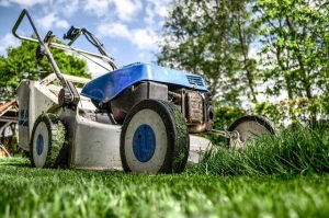 photo of lawnmower cutting grass