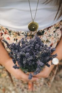 How to Use Essential Oils -- woman holding bouquet of lavender