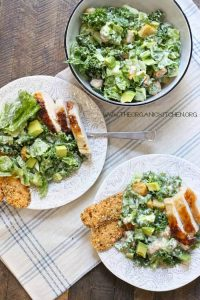 healthy kale recipes -- photo of kale chicken caesar salad from The Organic Kitchen