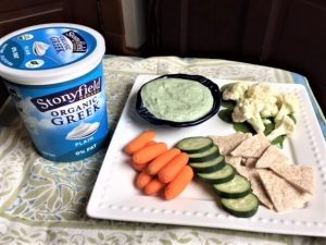 Greek yogurt dip -- photo of veggies and yogurt dip on platter next to carton of Stonyfield yogurt