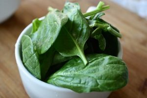 photo of bowl filled with spinach leaves
