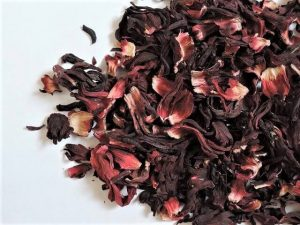 Benefits of hibiscus tea ~ Hibiscus tea is a delicious and refreshing drink that's been shown to help metabolism, blood pressure and more. Full of antioxidants, this gorgeous tea tastes great hot or cold. A perfect replacement for sugary beverages, hibiscus tea is my go-to herbal brew. Kids love it, too! #hibiscus #hibiscustea #sugarfree #health #naturalmedicine #bloodpressure #weightloss #metabolism #hibiscusteabenefits