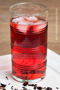 photo of hibiscus tea in glass with ice