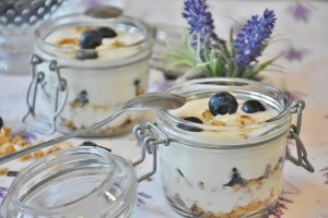 homemade yogurt, how to make yogurt -- closeup of yogurt parfaits in serving jars