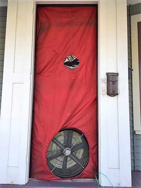 home energy audit -- photo of blower door test