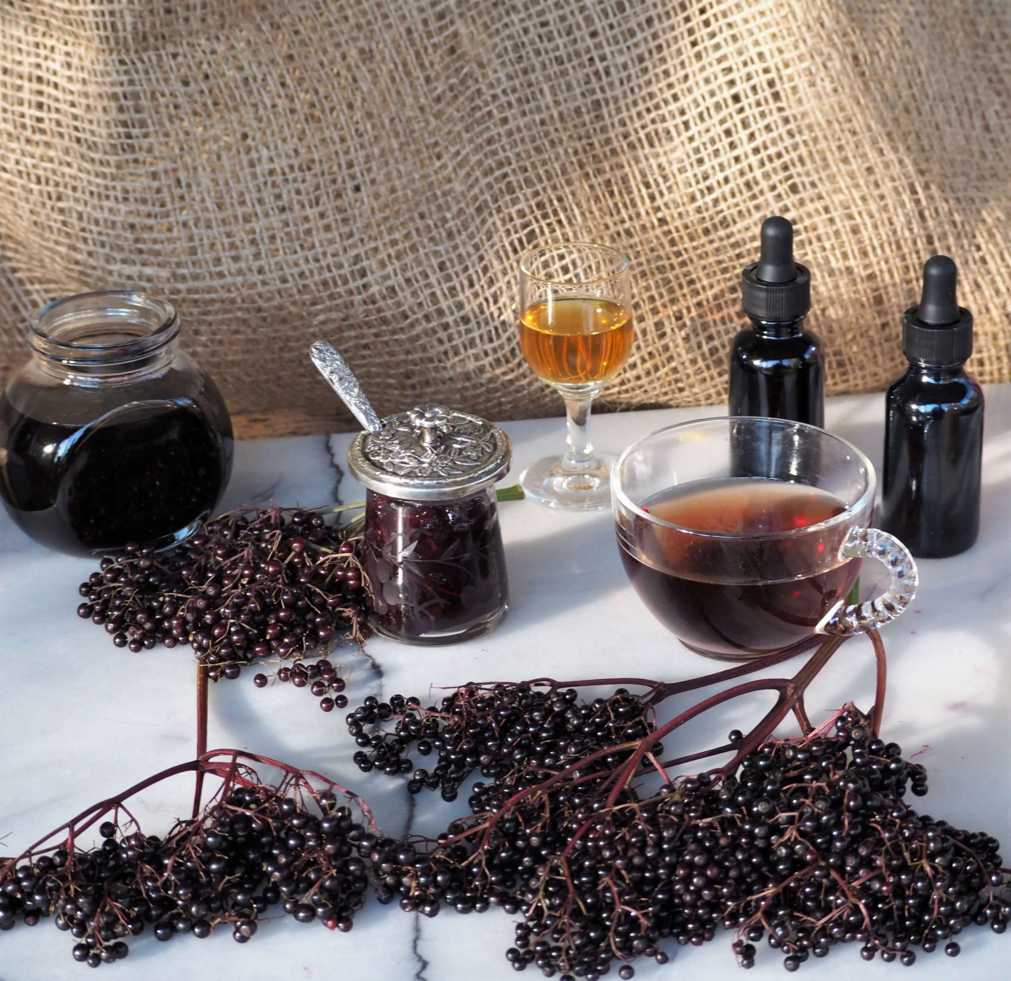 photo of elderberry uses, syrup, chia jam, tincture, elderflower liqueur, tea
