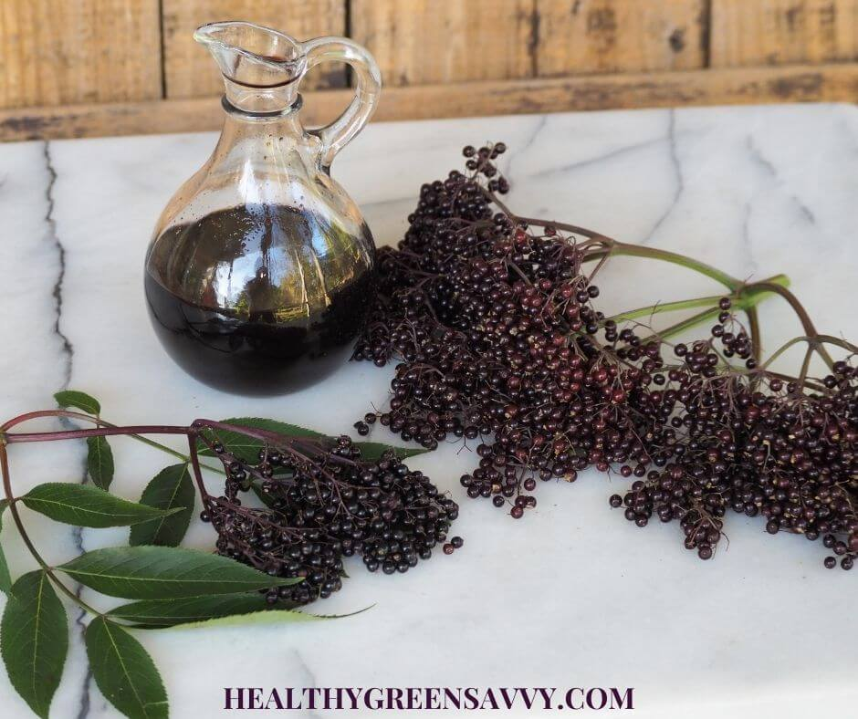 photo of homemade elderberry syrup and fresh elderberries