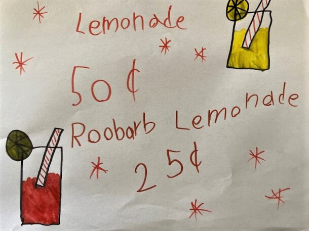 photo of sign my 6-year-old made for lemonade stand advertising discounted rhubarb lemonade