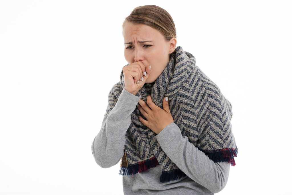 photo of woman coughing