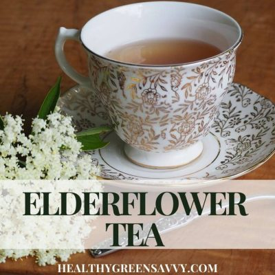 cover photo of cup of elderflower tea with spray of elderflowers