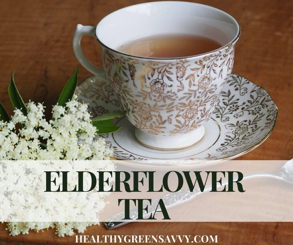 cover photo of cup of elderflower tea with spray of elderflowers